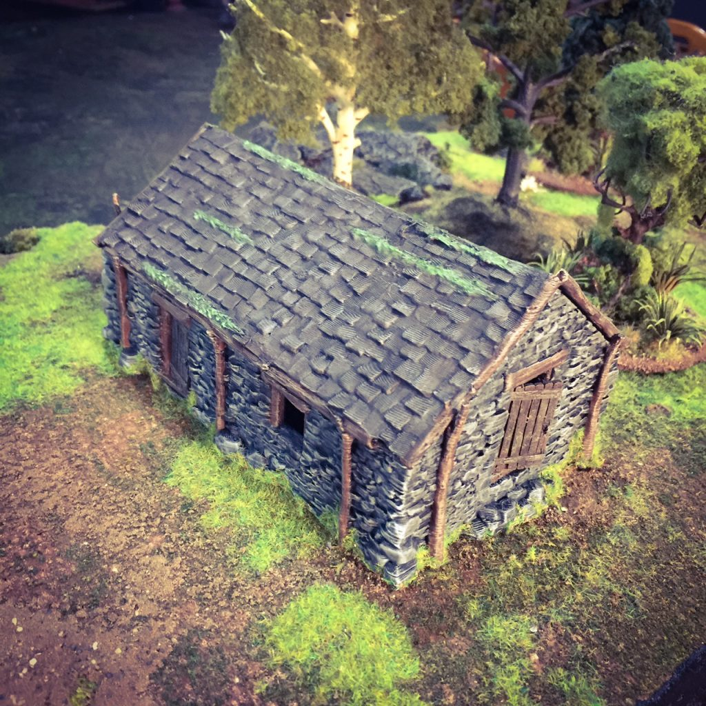 Completed 3d printed Stone Barn after painting and adding moss and grass