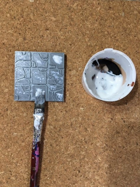 Pasting glue onto rampage tile
