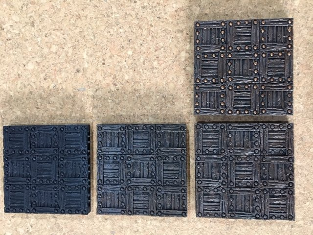 Wooden tiles in various painting stages