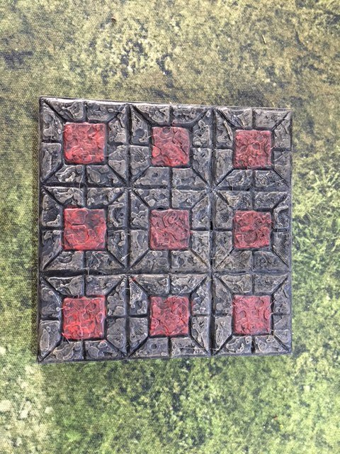 This castle floor tile has had the squares painted red for effect